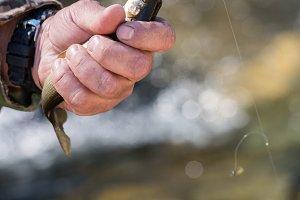 Fisherman holding caught