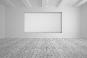 White room with screen in wall