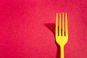 Yellow fork on red background