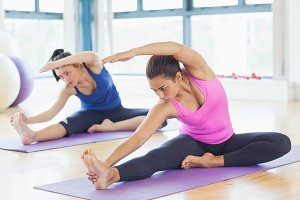 Fit women doing stretching pilate exercises