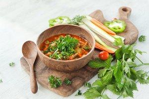 Vegetarian soup in wooden bowl