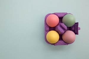 Colorful easter eggs in carton box