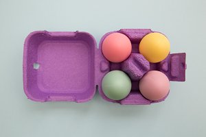 Cute easter eggs in carton box