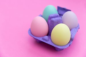 Easter eggs box on pink background