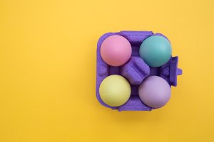 Easter eggs box on yellow background