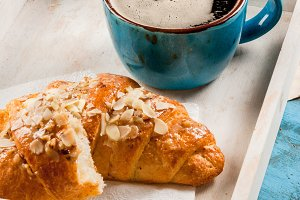 Large coffee mug and croissant