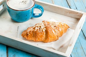 Large coffee mug and croissant