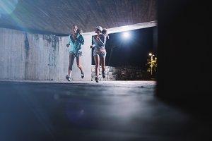Two young women jogging