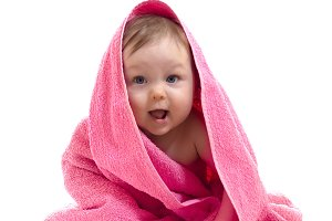 Little boy under pink towel