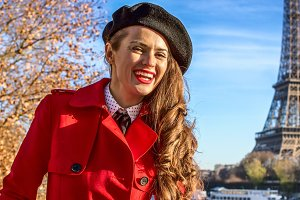 happy young woman on embankment in Paris, France