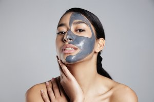 mixed race woman with facial mask
