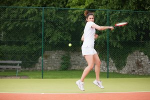 Pretty tennis player playing on court