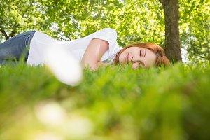 Pretty redhead lying on the grass