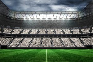 Large football stadium with fans in white