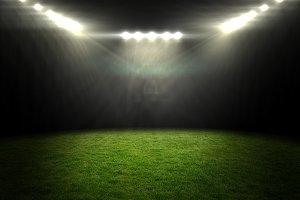 Football pitch under bright spotlights