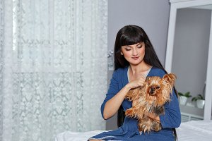 Girl and yorkshire terrier