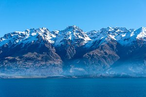 Lake Wakatipu landscape with snow covered mountains