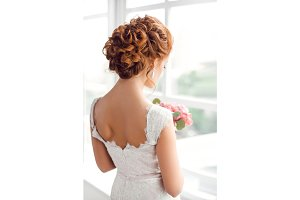 Beautiful bride with fashion wedding hairstyle