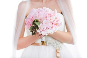 Bridal bouquet Beautiful of pink wedding flowers in hands of the bride
