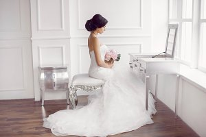 Young beautiful bride preparation at home