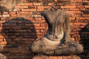 Ancient sandstone Buddha statue