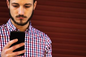 young hipster man with mobile phone