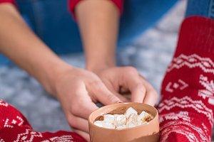 female feet and hot chocolate