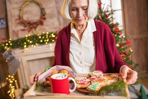woman holding tray with cookies
