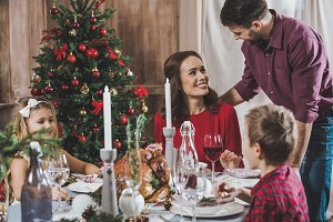 Happy family at holiday table