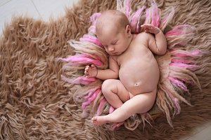 Sweet newborn baby sleep on wool