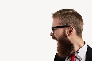 Side view portrait on shout bearded man. Close up shot of aggressive guy emotion. Free space for cry text.