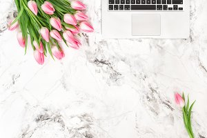 Laptop and tulip flowers JPG