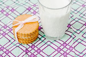 Transparent glass with milk and cookies.