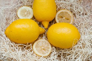 Three lemons, close-up in the straw