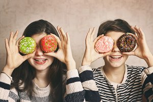 teen siblings boy and girl with dough nut eyes