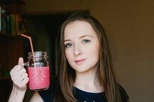 Girl drinks fruit drink