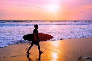 Surfer at Balinese beach, Indonesia