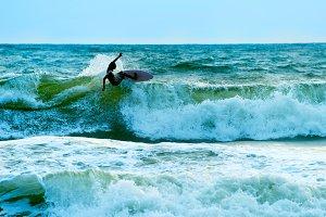 Surfer in the ocean. Bali