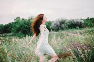 beautiful girl running in field