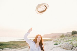 beautiful girl throws hat