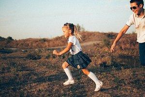 a little girl runs across the field