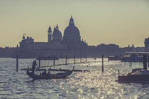 Gondola tour at sunset in Venice