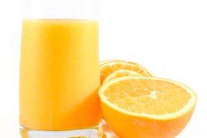Orange juice over white isolated
