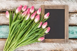 Tulip flowers with chalkboard