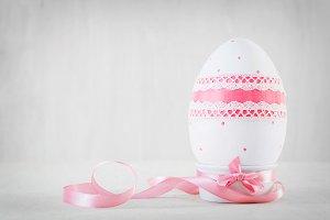 Single easter egg on wooden table. Decoupage art