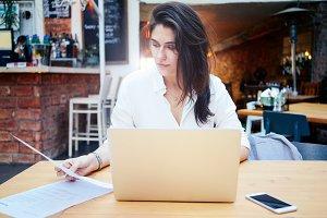 Female freelancer using laptop