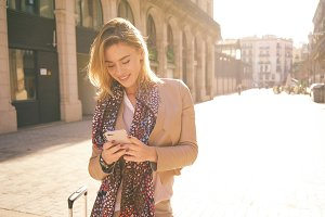 Young woman messaging on smart-phone