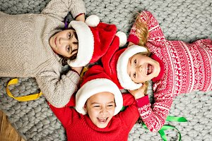 kids in Santa hats lying in circle
