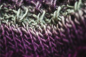violet and green wool scarf knitted texture closeup macro