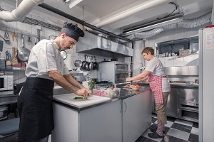 two people cooking kitchen